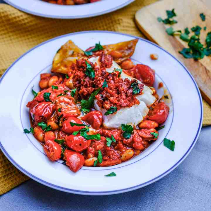 chorizo crusted cod over smokey tomato and white bean stew