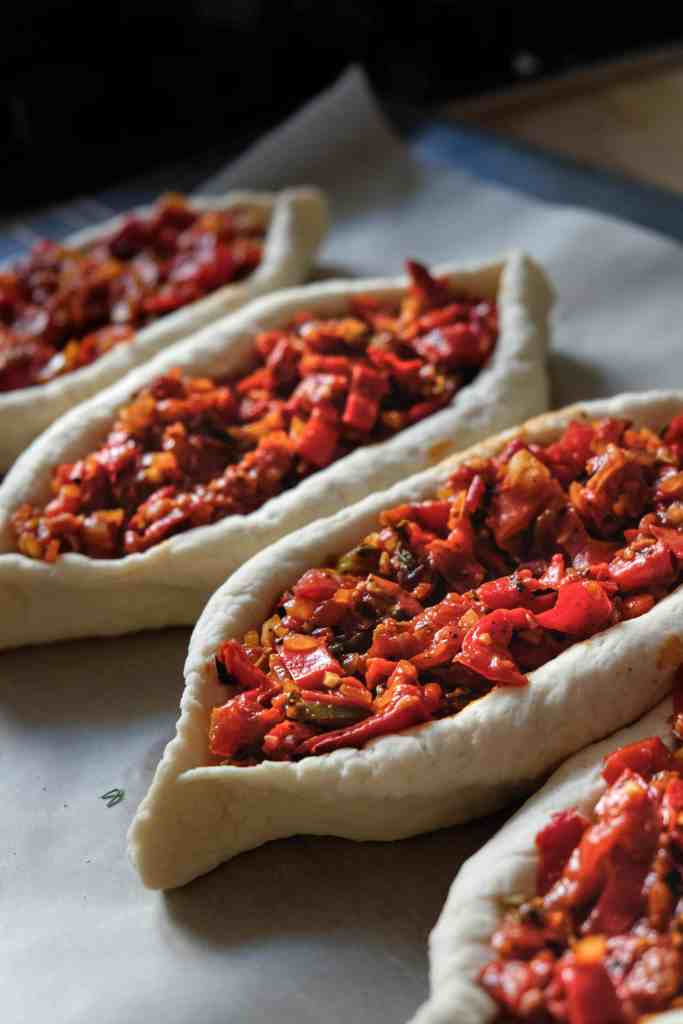 khachapuri dough boats filled with shakshuka