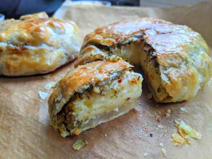 food & cooking monthly roundup baked camembert with pesto, almonds and chilli flakes