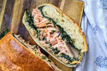 Sourdough salmon loaf made with homemade dough and creamed spinach spiked with garam masala.