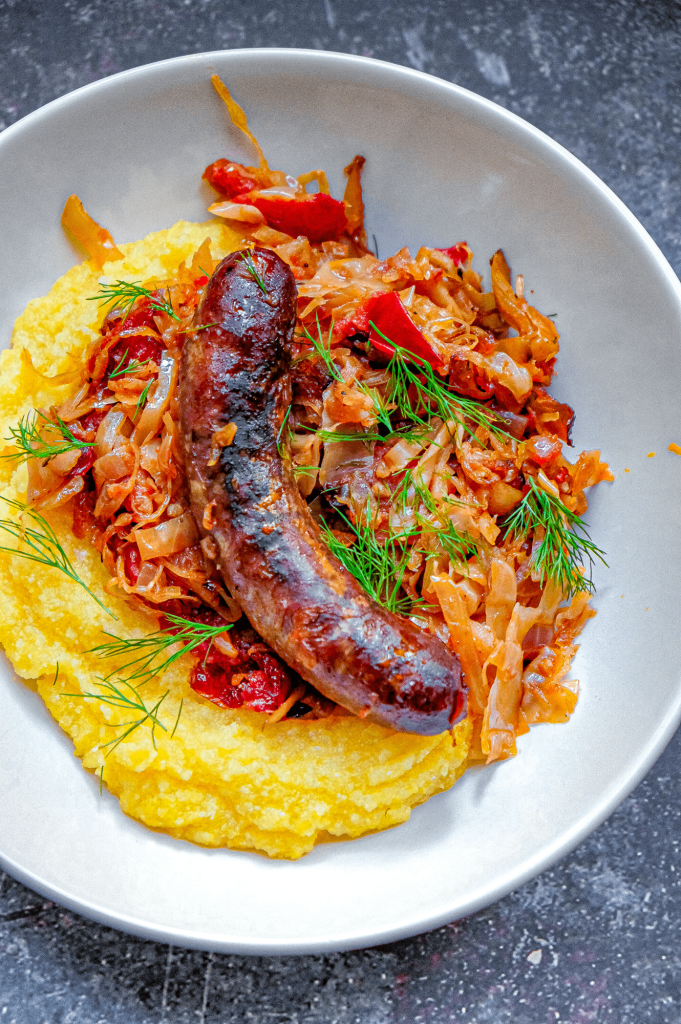 Slow roasted cabbage and sausages.