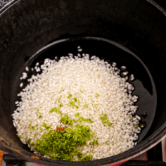 Preparing coconut lime rice with cilantro and black beans