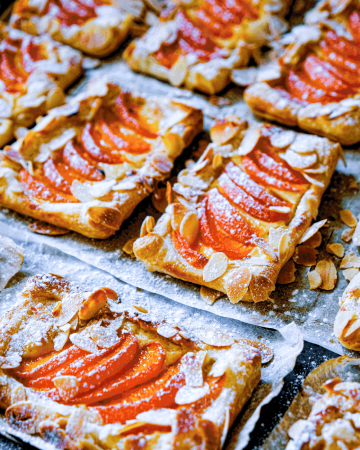 Elegant apricot and almond tarts with a luscious cream cheese base over light and airy puff pastry pockets. These not-too sweet tarts are the perfect dessert for your next summer gathering.
