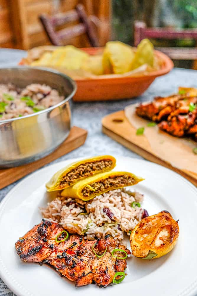 Jamaican jerk chicken with rice and peas and beef patties