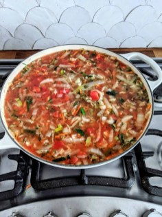 After the cabbage and aromatics have reduced you add the tomato, water and seasoning.