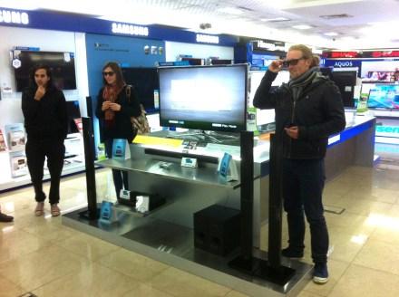 Shopping for speakers, admiring 3D TVs.