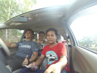 Groupie in a car. A group of young men doing selfie using selfie stick while they are still in a car (photo by Andika R)
