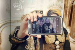 Selfie Couple. A bride and a groom taking selfie on their wedding party in Indonesia (photo by Ari E)