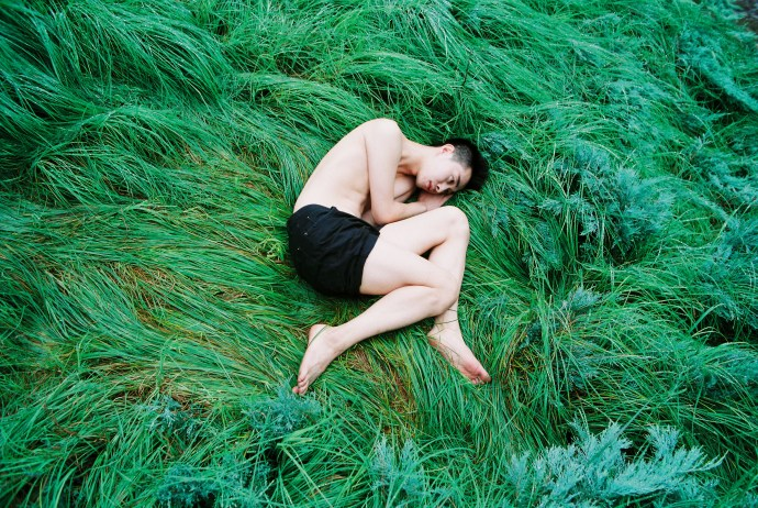REN Hang - China Untitled (boy on green grass) 2011 67 x 100 cm., Photography C-print Collection of the SUNPRIDE Collection Image Courtesy of artist and Sunpride Foundation