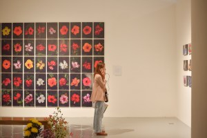 Exhibition view of SPECTROSYNTHESIS II showing Naraphat Sakarthornsap's Perfect Flower (2016:2019) along the back wall. Image courtesy of the Bangkok Art and Culture Centre and Sunpride Foundation.