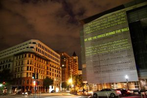 Hank Willis Thomas's ongoing collaboration with Incarceration Nations Network, Writing on the Wall projected onto the U.S. Department of Justice building. Image courtesy of Chemistry Creative.