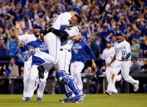 Kansas City Royals relief pitcher Wade Davis and catcher Salvador Perez celebrates their 4-3 win against the Toronto Blue Jays in Game 6 of baseball's American League Championship Series on Friday, Oct. 23, 2015, in Kansas City, Mo. (AP Photo/Matt Slocum)
