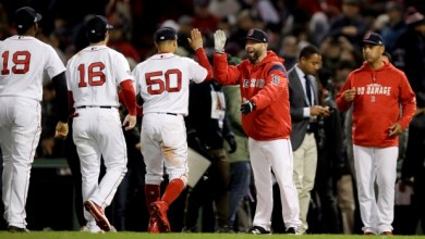 Boston Red Sox players celebrate the team's 7-5 victory over the Houston Astros in ALCS Game Two