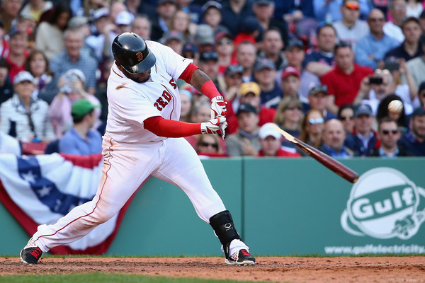 Boston Red Sox third baseman Pablo Sandoval hits a ball that saws off his bat during the eighth inning of a game in April 2015