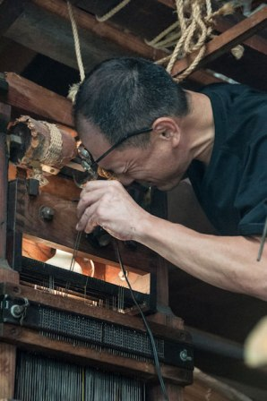 Examining the Jacquard pin assembly, Sasaki workshop