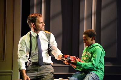 12. l-r Ben Richards (Frank Farmer) and Mickell Stewart-Grimes (Fletcher) in The Bodyguard at the Dominion Theatre. Photo credit Alessandro Pinna