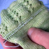 All stitches picked up along the bottom lifeline. Now time to pull the needle so they rest onto the cord of the circular needle...