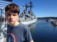 Don't let the face fool you. He loved running around the U.S.S Turner Joy historic navy ship in Bremerton.