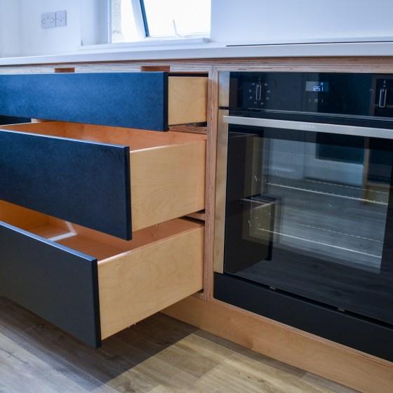 Birch Plywood Kitchen with Black Valchromat, handles doors