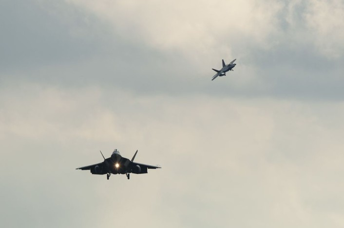 Two F-22 Raptor fighter aircraft prepare to land at Spangdahlem Air Base, Germany, Aug. 28, 2015, as part of the inaugural F-22 training deployment to Europe. Four F-22s from the 95th Fighter Squadron at Tyndall Air Force Base, Fla., along with a C-17 Globemaster III cargo aircraft and more than 50 support Airmen were part of the deployment. This effort is part of the European Reassurance Initiative and will serve to assure allies of the Air Force's commitment to European security and stability. (U.S. Air Force photo by Staff Sgt. Chad Warren/Released)