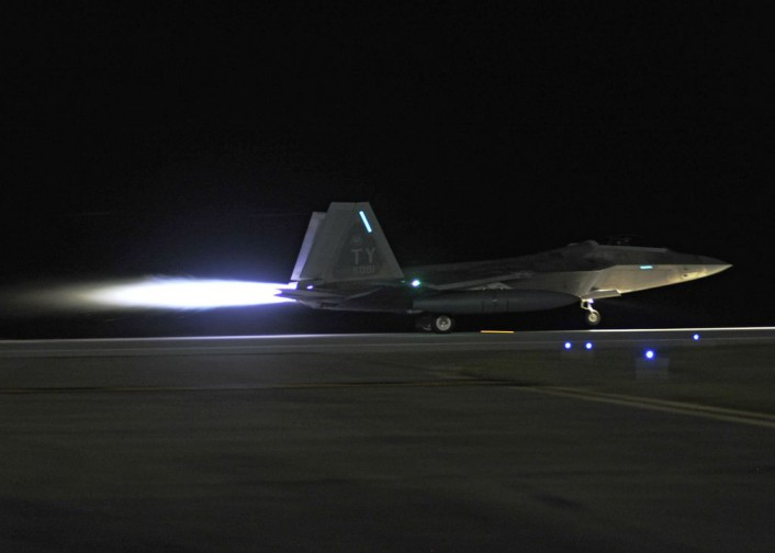 A 95th Fighter Squadron F-22 Raptor accelerates as it takes off of the Tyndall Air Force Base, Fla., flightline. Four 95th FS Raptors flew to Spangdahlem Air Base, Germany, to train with allied air forces and U.S. services through mid-September. (U.S. Air Force photo by Airman 1st Class Sergio A. Gamboa/Released)