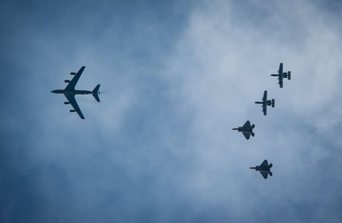 A KC-135 Stratotanker along with two F-22 Raptors and two A-10 Thunderbolt IIs fly overhead before landing at Ämari Air Base, Estonia, Sept. 4, 2015, as part of a brief forward deployment. The F-22s have previously deployed to both the Pacific and Southwest Asia for Airmen to train in a realistic environment while testing partner nations' ability to host advanced aircraft like the F-22. The F-22s are deployed from the 95th Fighter Squadron at Tyndall Air Force Base, Florida. The U.S. Air Force routinely deploys aircraft and Airmen to Europe for training and exercises. (U.S. Air Force photo/ Tech. Sgt. Ryan Crane)