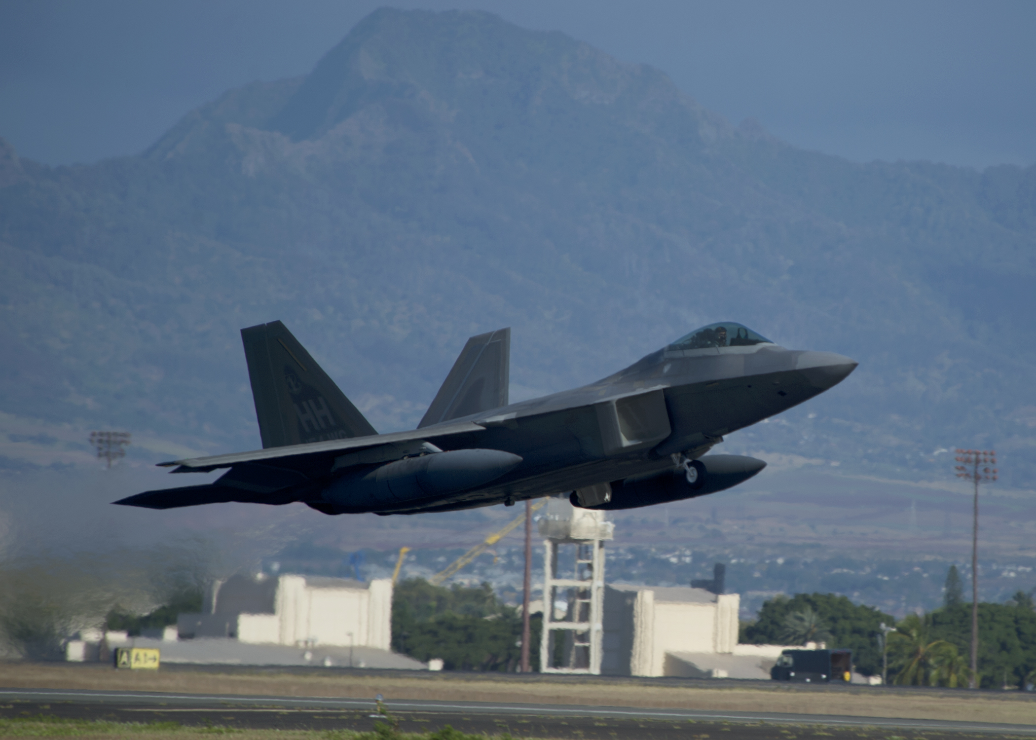 A United States Air Force F-22 Raptor, from the Hawaiian Raptors, takes off from Joint Base Pearl Harbor-Hickam, Hawaii, April 20, 2015. The Hawaiian Raptor is traveling to Nellis Air Force Base, Nev., to take part in a joint training event. (U.S. Air Force photo by Tech. Sgt. Aaron Oelrich/Released)