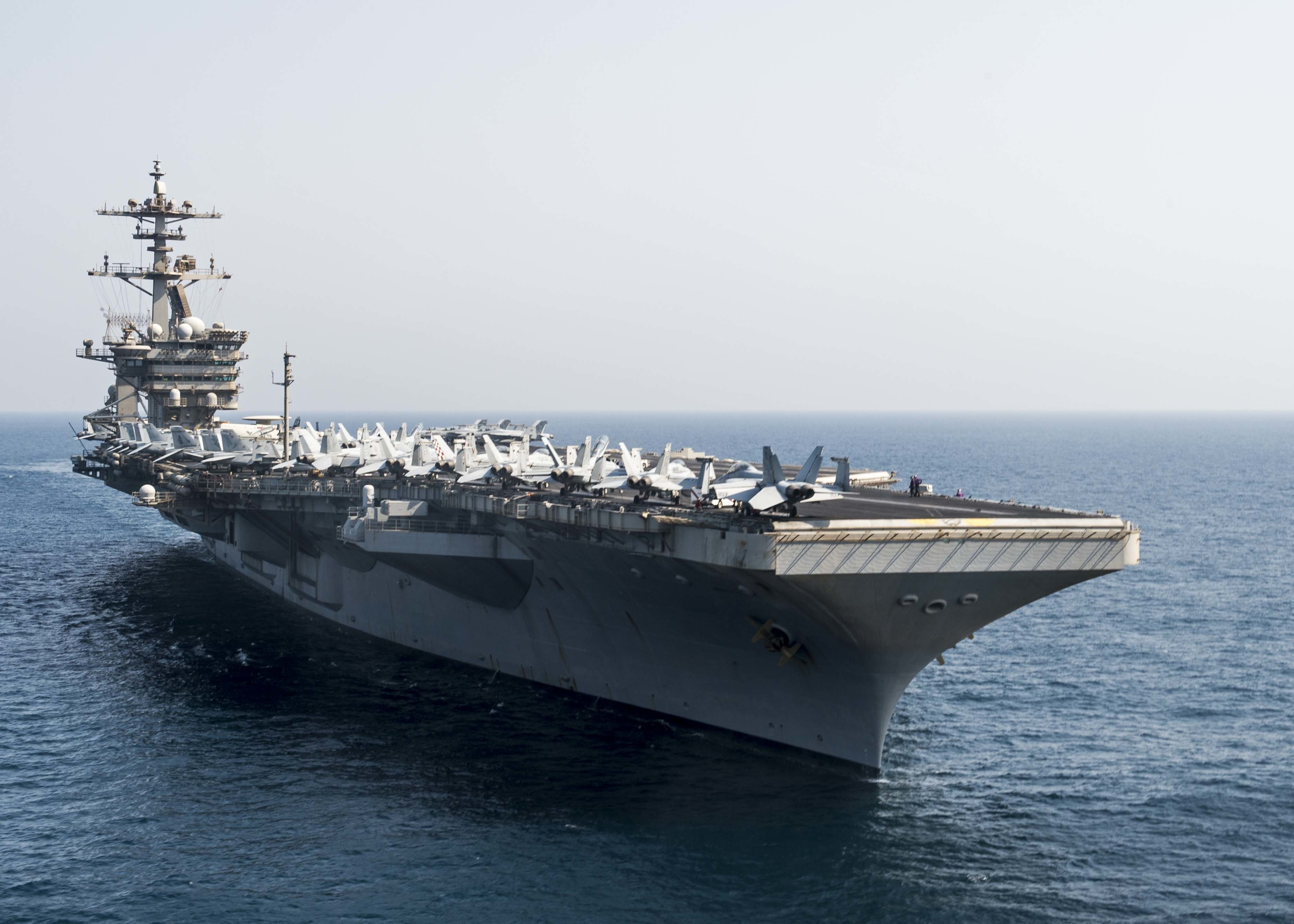 151002-N-SB299-367 ARABIAN GULF (Oct. 2, 2015) The aircraft carrier USS Theodore Roosevelt (CVN 71) transits the Arabian Gulf. Theodore Roosevelt is deployed in the U.S. 5th Fleet area of operations supporting Operation Inherent Resolve, strike operations in Iraq and Syria as directed, maritime security operations and theater security cooperation efforts in the region. (U.S. Navy photo by Mass Communication Specialist Seaman Alex Millar/Released)