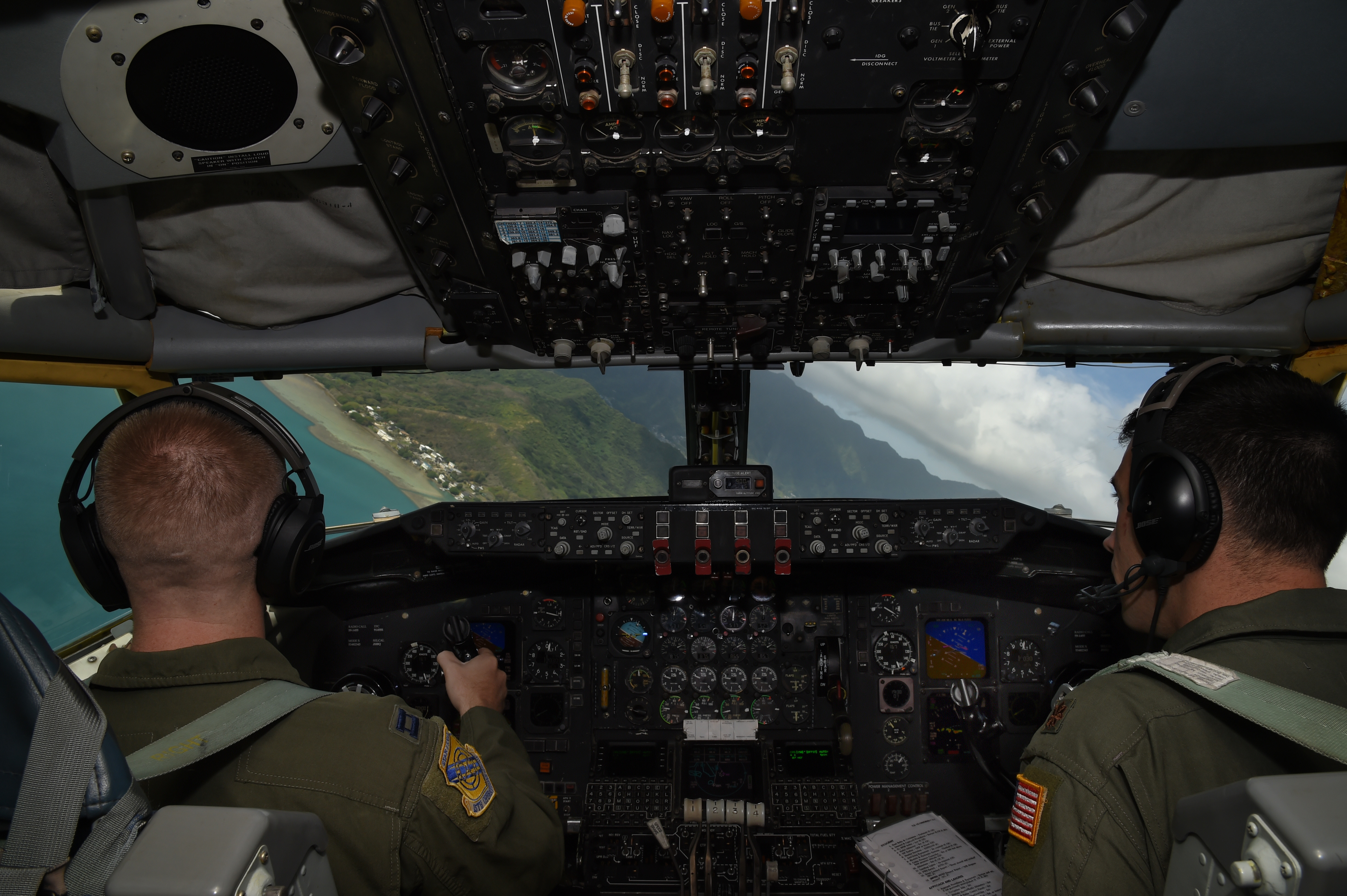 (Left) Capt. Ryan Miller and Maj. Dan Allen, both pilots for the 96th Air Refueling Squadron, turn the KC-135R Stratotanker in preparation for a touch and go landing on Marine Corps Air Station Kaneohe Bay, Hawaii, May 19, 2015. (U.S. Air Force photo by Tech. Sgt. Aaron Oelrich/Released)