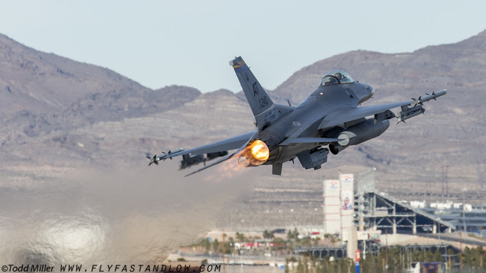 F-16C of the AATC (Tucson, AZ) in a guest appearance launches from Nellis AFb on Red Flag 16-1 sortie.