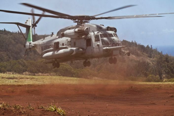 U.S. Marine CH-53E Super Stallion helicopters assigned to Marine Heavy Helicopter Squadron 463, land in Landing Zone Canes on Oahu, Hawaii, April 29th, 2016. HMH-463 extracted the 3rd Battalion, 3rd Marine Regiment from Kahuku Training Area at the end of their field exercise by conducting multiple waves of assault support lift with the Army's 25th Combat Aviation Brigade.  (U.S. Marine Corps photo by Capt. Tim Irish)