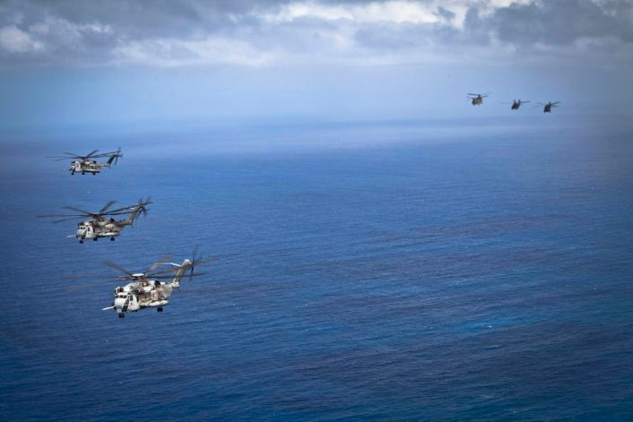 U.S. Marine CH-53E Super Stallion helicopters, left, assigned to Marine Heavy Helicopter Squadron 463, fly in formation with U.S. Army helicopters during interoperability operations off the coast of Oahu, Hawaii, April 29, 2016. HMH-463 conducted interoperability operations with the 25th Infantry Division's 25th Combat Aviation Brigade.  (U.S. Marine Corps photo by Cpl. Aaron S. Patterson)