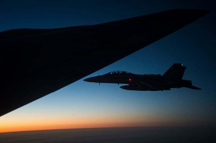 A U.S. Navy F/A-18 Super Hornet flies off the wing of a KC-135 Stratotanker over Iraq after refuel Sept. 28, 2016. Airmen from the 340th Expeditionary Air Refueling Squadron refueled U.S. Navy F/A-18 Super Hornets over Iraq in support of Combined Joint Task Force-Operation Inherent Resolve. The U.S. and more than 60 coalition partners work together to eliminate Daesh and the threat they pose to Iraq and Syria. (U.S. Air Force photo/Tech. Sgt. Larry E. Reid Jr., Released)