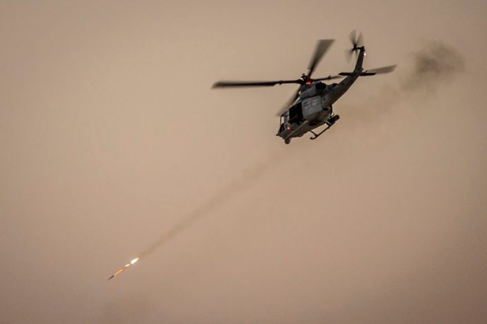 A U.S. Marine Corps UH-1Y Venom assigned to Marine Aviation Weapons and Tactics Squadron One (MAWTS-1) engages targets during an urban close air support exercise at Yodaville, Yuma, Ariz., Sept. 30, 2016. The urban close air support exercise was part of Weapons and Tactics Instructor Course (WTI) 1-17, a seven-week training event, hosted by MAWTS-1 cadre, which emphasizes operational integration of the six functions of Marine Corps aviation in support of a Marine Air Ground Task Force. MAWTS-1 provides standardized advanced tactical training and certification of unit instructor qualifications to support Marine Aviation Training and Readiness and assists in developing and employing aviation weapons and tactics. (U.S. Marine Corps photo by Lance Cpl. Danny Gonzalez 1st MARDIV COMCAM)