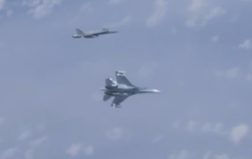 Russian Su-27 pushes North Atlantic Treaty Organisation jet fighter from Defense Minister Shoigu's plane