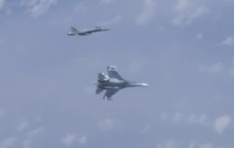 Spanish EF-18 Hornet Shadowing Russian Defense Minister's Jet Gets Shooed Away By Escorting Su-27 Flanker