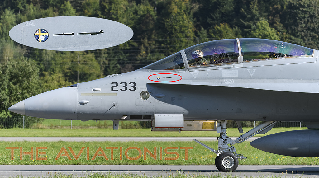 theaviationist.com - Swiss F/A-18D Hornet Sports Markings For MQM-178 Target Drone Kill With AIM-120C-7 During Tests in Sweden