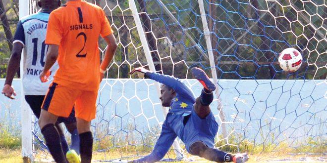 Corps of Signal goalkeeper, Binu Purushothama, could not stopGuardian Angel SC's Alvito Miranda from opening the scoring. Photo Courtesy: The Navhind Times