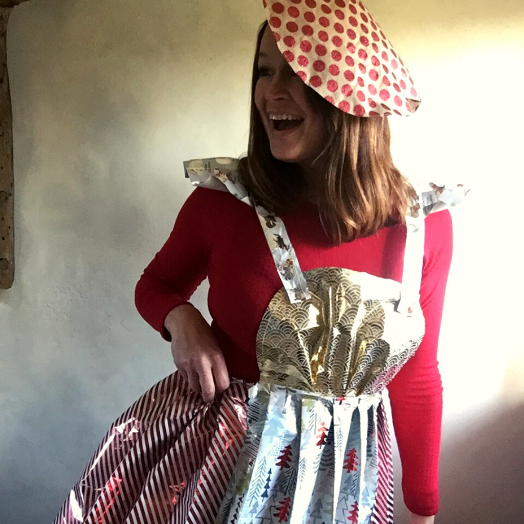 Blogger Ulla Lake wearing a recycled wrapping paper fashion apron dress and paper craft beret hat