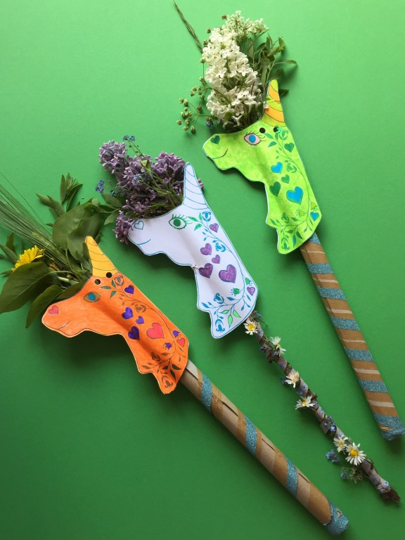 three eco friendly diy cardboard unicorn wands made with recycled pizza boxes and our free unicorn printable kids craft activity