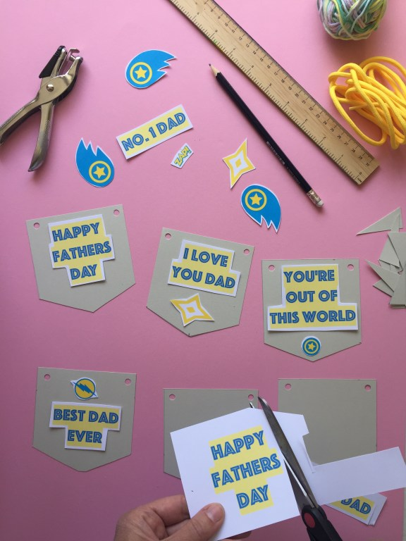 cut out the printable shapes to create your superhero themed kids homemade fathers day bunting