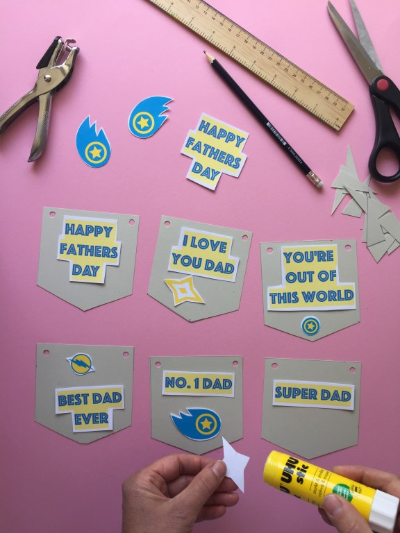 stick the shapes to the bunting to create your superhero themed kids homemade fathers day bunting