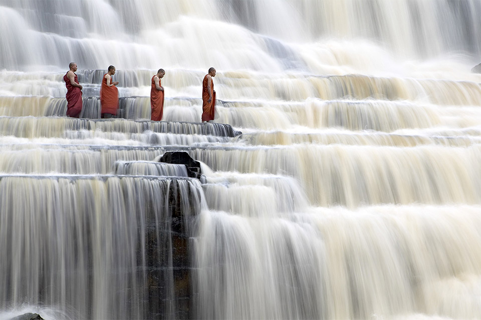 "Pongua Falls, Vietnam (image: <a href=""http://en.yellowkorner.com/photos/69/monks-in-waterfalls.aspx"" target=""_blank"">Dang Ngo</a>)"