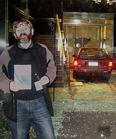 "DRIVE-IN: David Theobald poses for a self-portrait of himself with his car ""parked'' inside IRD's Christchurch office."