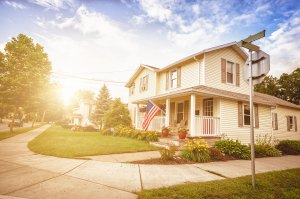 A corner house with the American flag on the porch