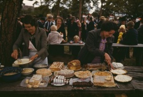 vintage photograph of potluck farm dinner
