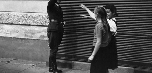 Two young girls give nazi salute during World War II