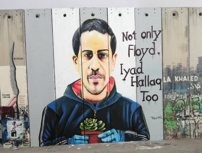 A mural depicting Eyad Hallaq in Bethlehem.