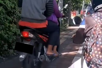 Some Bali Locals Continue To Ride Motorbikes On Sidewalks Risking The Lives Of Pedestrians