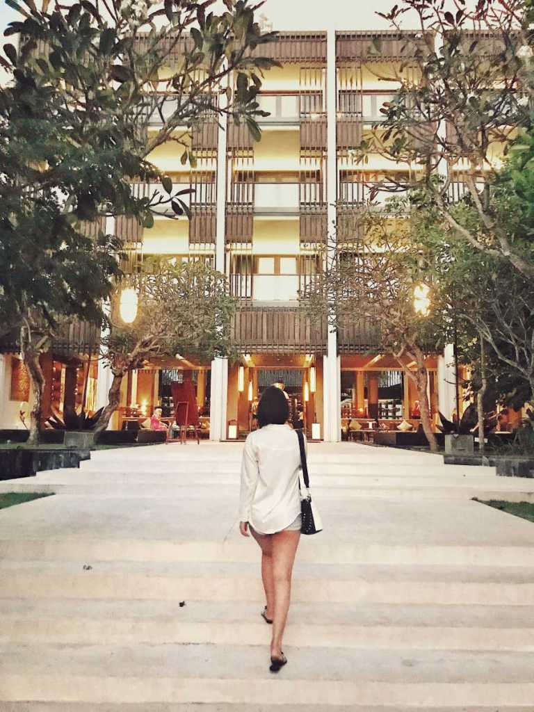 Woman in front of bali hotel